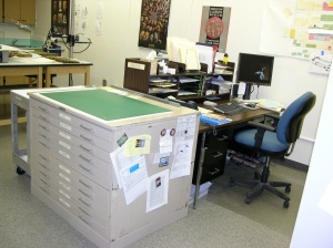 Cutting area for boxmaking and storage supports, conservation office area.
