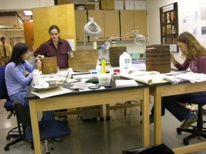 Samantha Springer and Molly Gleeson work on projects as Ellen supervises and Bruce approaches