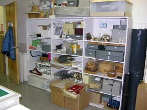 These shelves contain samples of various natural materials for testing as well as completed Oddy tests, examples of various pests for IPM, and a lovely heat spatula tool with beautiful silver tips.  The boxes in front contain freezer kits for low temperature storage of the photos associated with the herbarium collection.