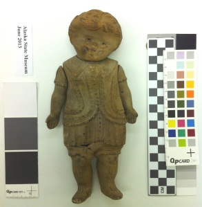 Doll recovered from a 1901 shipwreck, possibly made of gutta percha?