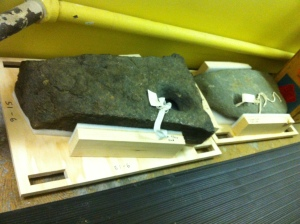 """These anchor stones are padded and bumpered using wooden pallets with handholds and a """"foot"""" underneath."""