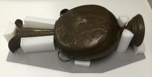 Custom support for metal vessel.