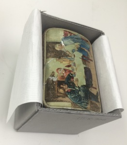 A Tyvek lifting sling for this painted metal box.
