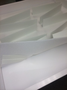 These drawers dividers made of blotter paper are then slipped through slots in a sheet of polyethylene foam and...