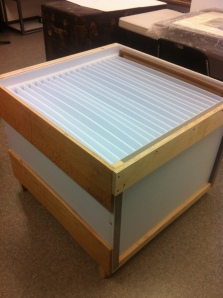 Fluted plastic (Coroplast or Correx) with a frame of wood makes good in-house temporary storage for framed art.