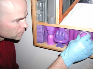 "Conservator Scott Carrlee replaces an element from David Mollett's ""Collection Cabinet"" (ASM 2005-29-1) after consultation with the artist in 2006."