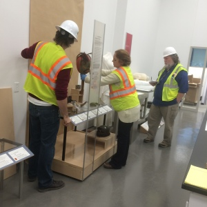 From L to R: exhibit designer Aaron Elmore, exhibits curator Jackie Manning and curator Steve Henrikson working together on the layout for the Resilience section of the new exhibits.