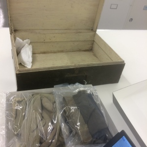 This barracks box from the Aleutian campaign contains clothing that must be addressed.  It may need to be vacuumed, and the arrangement and support of the garments in the box needs to be determined with aesthetics, interpretation, and long term preservation in mind.