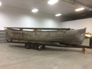 ASM 97-34-1Bristol Bay Double Ender, a fishing boat that will go on display, rigged with a new sail made by master sail maker Louie Bartos, and film footage will be projected on the replica sail.