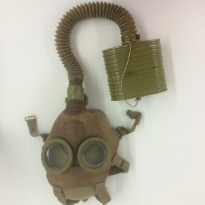 This gas mask, III-O-165, has a lot of rubber components that are still flexible, but who knows how long that flexibility will last?  Can we come up with a support system that will allow the item to be interpreted and studied in the future even when it gets stiff?