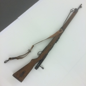 This Japanese rifle, III-O-240, has areas of corrosion and some elements that might be bent or out of position.  It is an Arisaka Model 99 collected at Kiska.