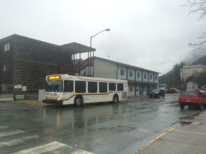 There's the bus, it stops several places near the site.  And the building with the blue stripes is Thibodeau's, which has a convenience store for sandwiches and coffee and friendly banter with Henry.