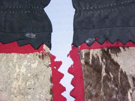 detail of moth-damaged mittens