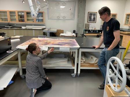 Conservator and exhibit designer discuss artwork